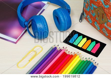School Supplies. School Backpack, Book, Color Pencils, Paper Clip, Color Bookmarks And Headphones On