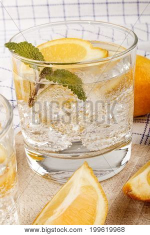 sparkling mineral water with lemon and ice cube
