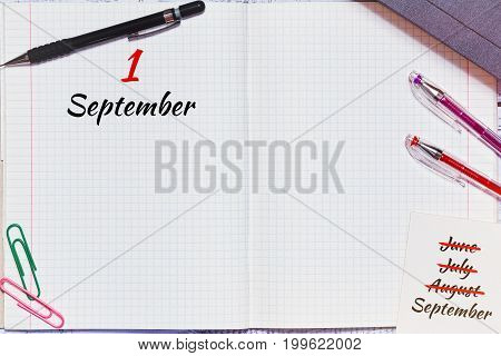 Beginning of academic or school year - opened copybook with different colorful education accessories in tip view