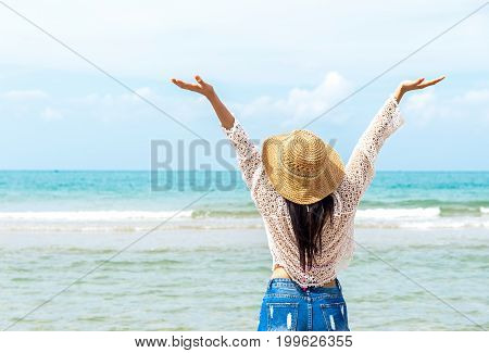 Happy lifestyle asian woman relax on the beach in summer. Travel Concept
