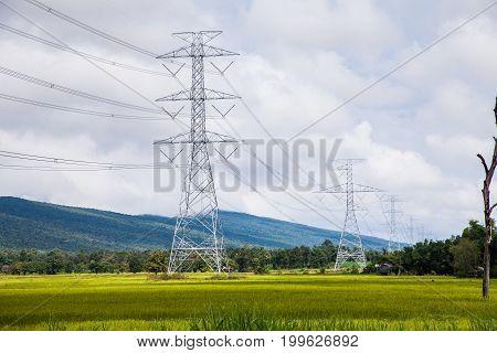 High voltage power pole sky background, Thailand.