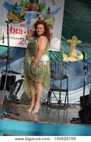winner in nomination of Sweet Voice Sirena  Olga Kruglova on traditional competition of best beautiful mermaid, August, 12, 2017, Viliya sea, Belarus