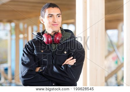 Handsome Carpenter With Arms Crossed Looking Away