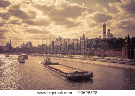 Barge floats on the Moskva River past Moscow Kremlin. Kremlin Embankment in Moscow, Russia.