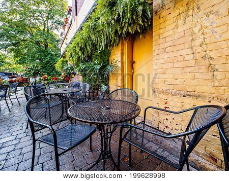 Outdoor patio of a restaurant in urban setting