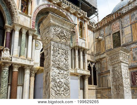 Ancient columns near the Basilica di San Marco (Saint Mark`s Basilica) in Venice, Italy. Basilica di San Marco was built in the 12th century and is the main tourist attraction of Venice.