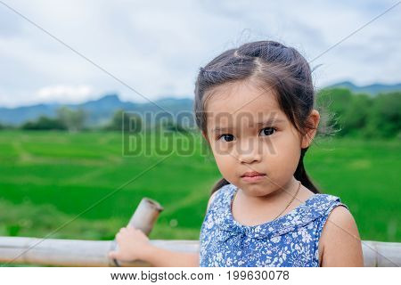 Portrait of Asian a sad little girl ,angry sad offended girl cries