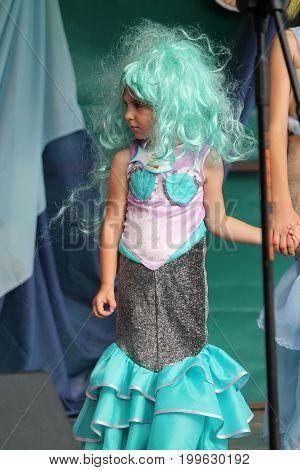 beautiful five year old Masha Gorn with blue hair on competition for best beautiful mermaid on
