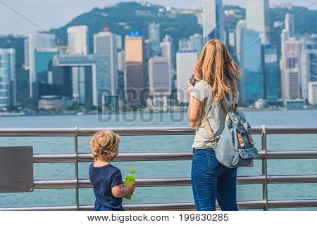 Young Woman And Her Son Taking Photos Of Victoria Harbor In Hong Kong, China