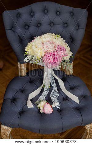 Wedding bouquet on chair.