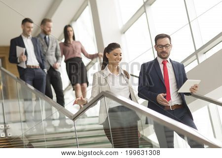 Young Business People On Stairs