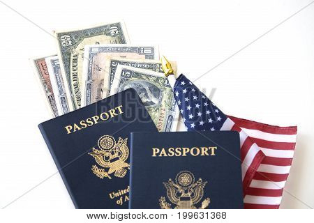 US passports and flag with Cuban paper currency