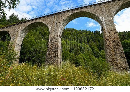 architectural arch stone train trestle in Black Forest Germany