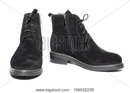 Female suede boots on white background isolated studio