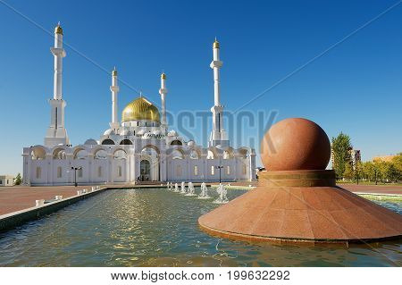 ASTANA, KAZAKHSTAN - SEPTEMBER 26, 2011: Nur Astana mosque exterior with the fountain at the foreground in Astana, Kazakhstan. This mosque is the second largest in Kazakhstan.