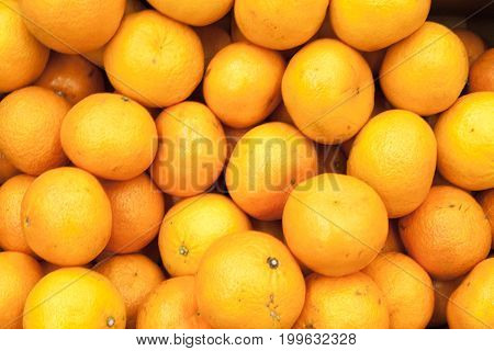 Tangerines background fresh bright tangerines Bunch of fresh mandarin oranges on market
