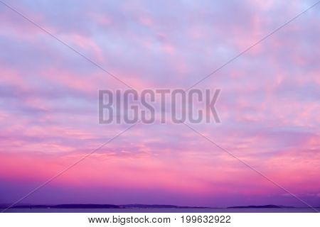 Dramatic sunset sky in deep purple pink and magenta colors.