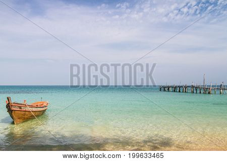Tropical beach and blue sea with long-tailed boat in Thailand