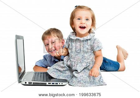 Cheerful children, sitting in front of laptop, isolated on white background