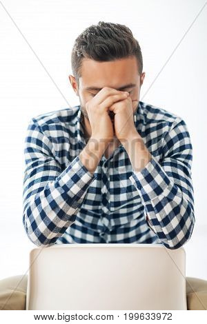 Portrait Of Stressed Despair Man Closed Face By Two Hands