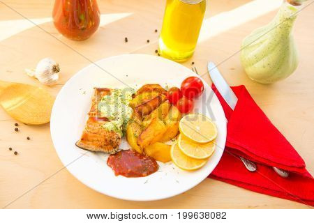 Salmon Filet With Baked Potatoes On Plate On Wooden Table