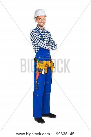 Full Length Portrait Of Happy Construction Worker In Uniform And Tool Belt