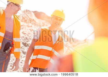 Happy supervisor with colleague at construction site