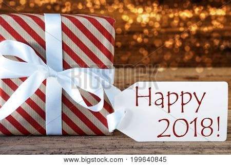Macro Of Christmas Gift Or Present On Atmospheric Wooden Background. Card For Seasons Greetings, Best Wishes Or Congratulations. White Ribbon With Bow. English Text Happy 2018