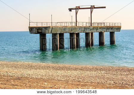 part of the pier on the black sea in Abkhazia, near the town