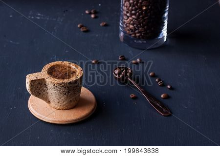 coffee in a cookie cup with coffee beans