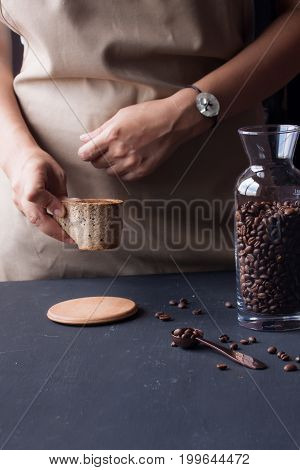 hand holding coffee with cookie coffee cup