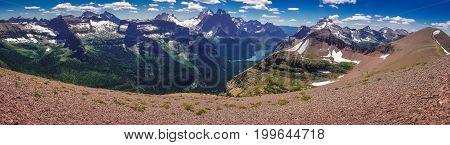Panoramatic view of mountains in Glacier NP, US from Acamina trail in Waterton Lakes NP in Canada