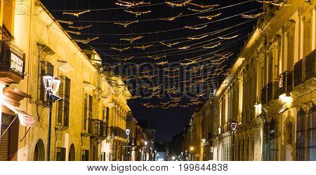 View on colonial old town of Oacaca city by night - in Mexico