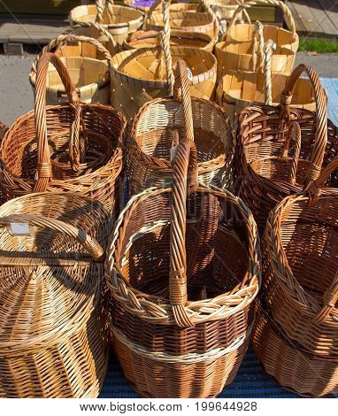 Several baskets on the counter in the market. The baskets are woven from the willow twig. A traditional Russian hand-made thing.