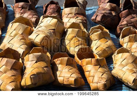 Traditional old Russian shoes - bast shoes woven from birch bark