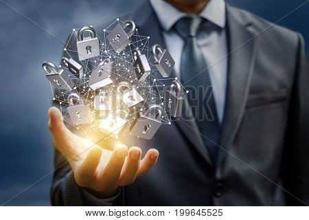 Network With Safety Locks In The Hand Of Businessman.