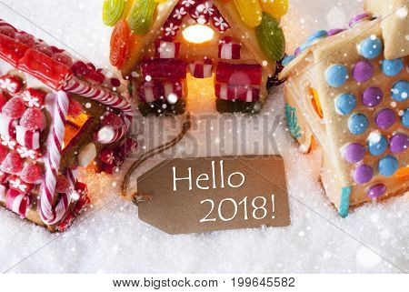 Label With English Text Hello 2018 For Happy New Year. Colorful Gingerbread House On Snow And Snowflakes. Christmas Card For Seasons Greetings