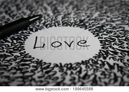 Inscription love inscription on a piece of paper symbolic image of love
