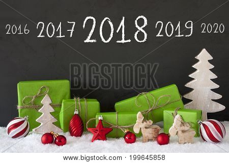 Timeline 2018 For Happy New Year. Green Gifts Or Presents With Christmas Decoration Like Tree, Moose Or Red Christmas Tree Ball. Black Cement Wall As Background With Snow.