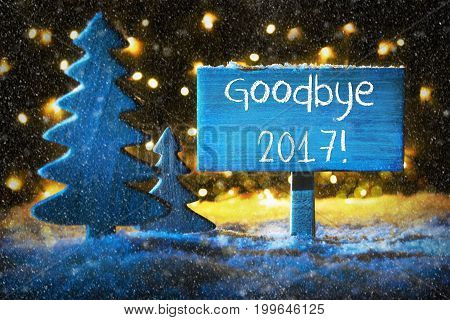Sign With English Text Goodbye 2017. Blue Christmas Tree With Snow And Magic Glowing Lights In Backround And Snowflakes. Card For Seasons Greetings.