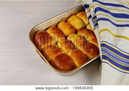 Challah bread with Pastryflour and sesame seeds.selective focus Holiday kosher buns