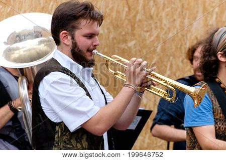 FERRARA Italy - August 20 2016: Buskers Festival 2016 in Ferrara Emilia Romagna Italy. Busker Festival is a popular event with street artists which is held annually in the historic center of Ferrara.In the picture a musician playing the accordion