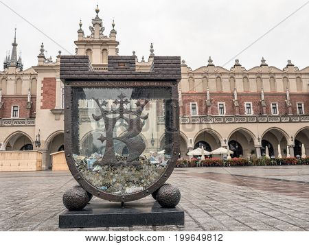 Stylized money-box at the Main Market Square in Krakow, Poland
