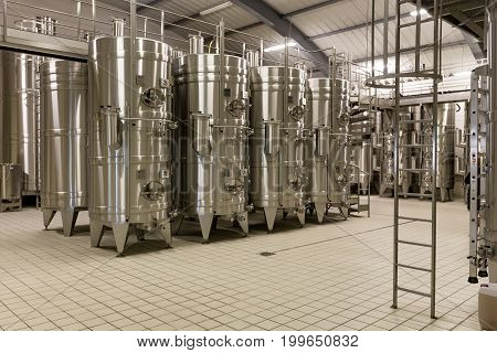 Wine Cellar And Production Barrels For Wine storage Modern Development Technology Concept. Inside modern wine factory