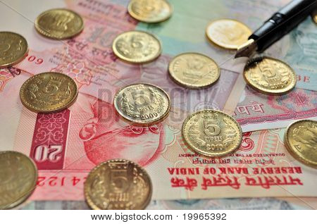 Indian Currency notes of denomination Rs.20, Rs.10, Rs.5 and Coins of denomination Rs.5 with a black fountain pen poster