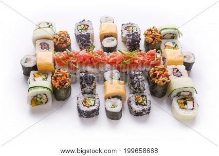 Big party sushi set isolated on white background. Japanese food delivery and take away. Fish and vegetable rolls with cheese and cucumber and spicy gunkans