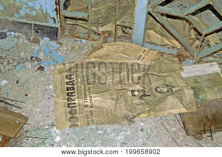 CHORNOBYL, UKRAINE -JULY 15, 2007: Old communist newspaper in abandoned building in school in Chernobyl Zone. Chornobyl Disaster