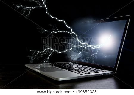 Laptop with lightning. Mixed media