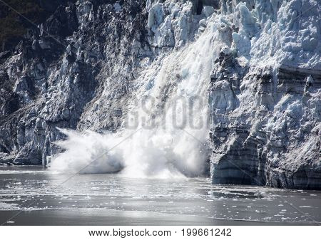 The falling ice of a glacier in Glacier Bay national park (Alaska).
