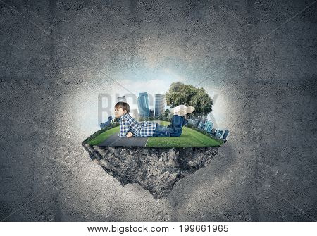 ECO concept floating island and happy kid boy on it